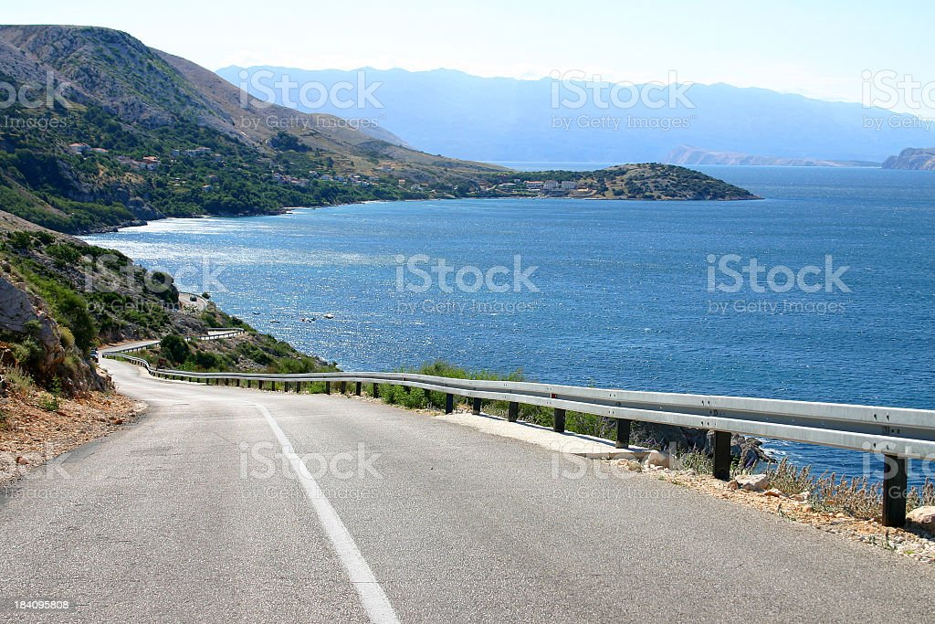 Asphalt road to drive on while admiring the scenic ocean royalty-free stock photo