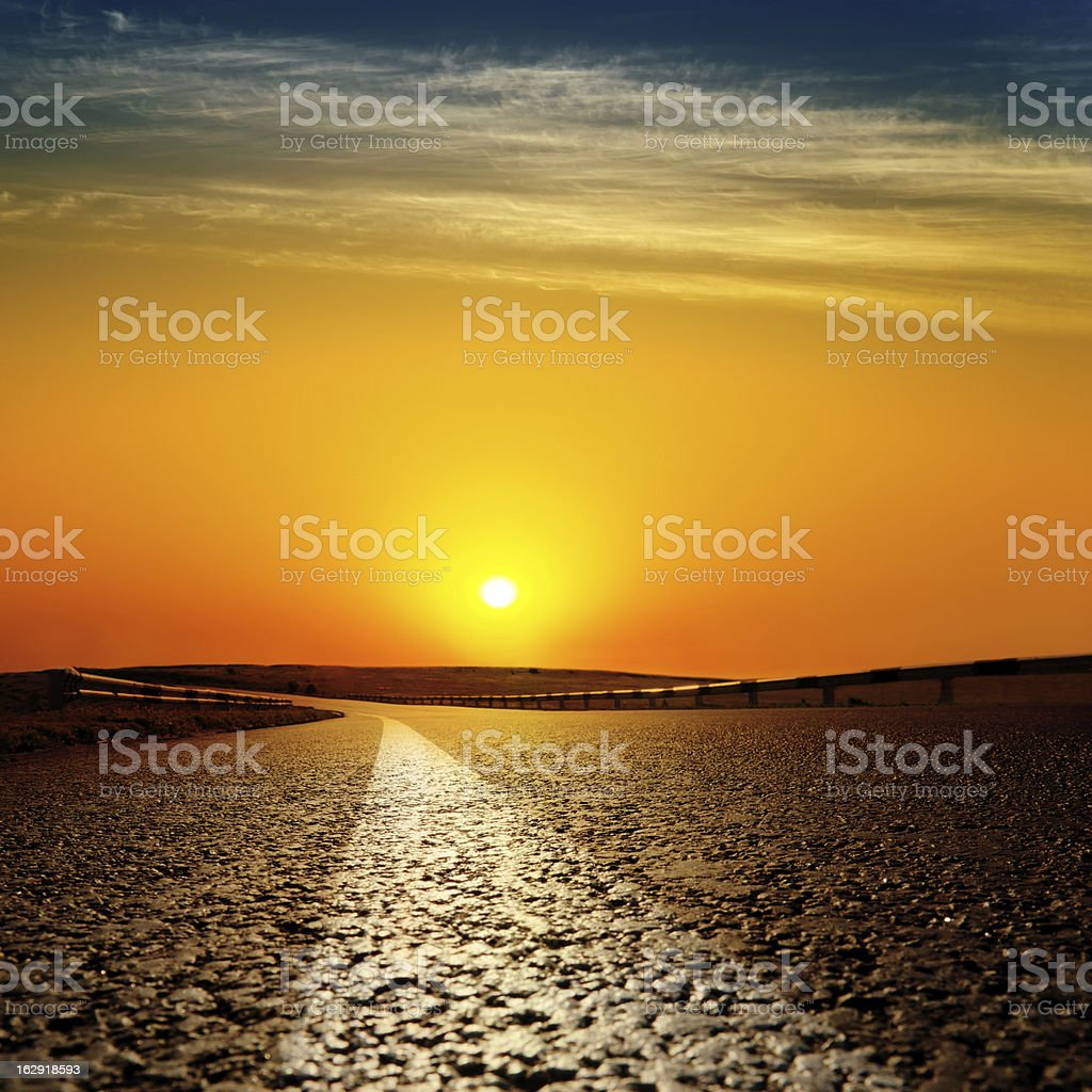 asphalt road to red sunset royalty-free stock photo