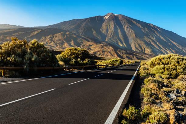Asphalt road under EL Teide volcanic, National Park, Tenerife, Spain stock photo