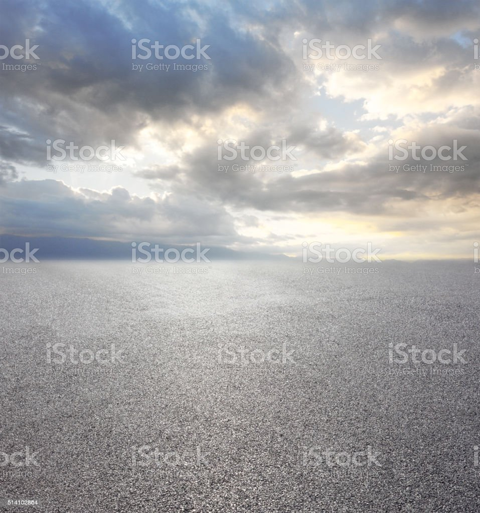 Asphalt road with cloudy sky and mountain background stock photo