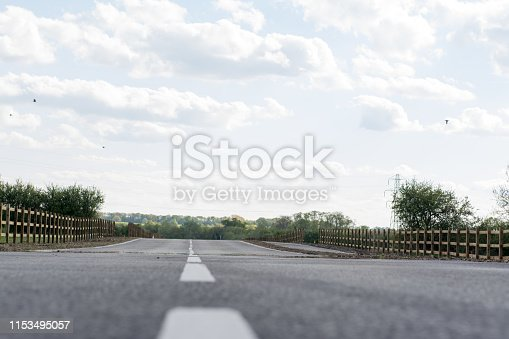 833130962 istock photo asphalt road with dividing lines 1153495057