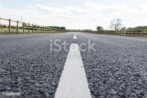 833130962 istock photo asphalt road with dividing lines 1153495180