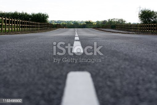 833130962 istock photo asphalt road with dividing lines 1153495932