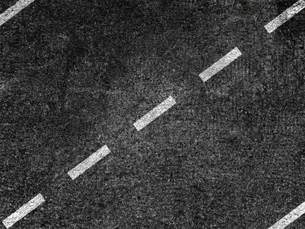 asphalt road with dividing white line - dotted line stock photos and pictures