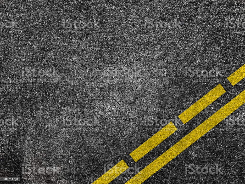 Asphalt road with dividing yellow lines. stock photo
