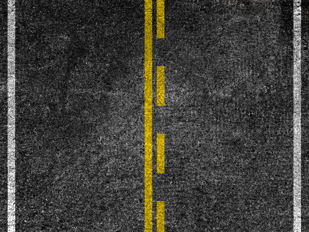 asphalt road with dividing yellow lines. - dotted line stock photos and pictures