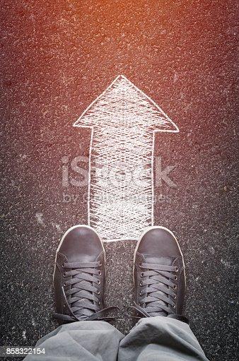 istock Asphalt road with drawn direction arrow 858322154