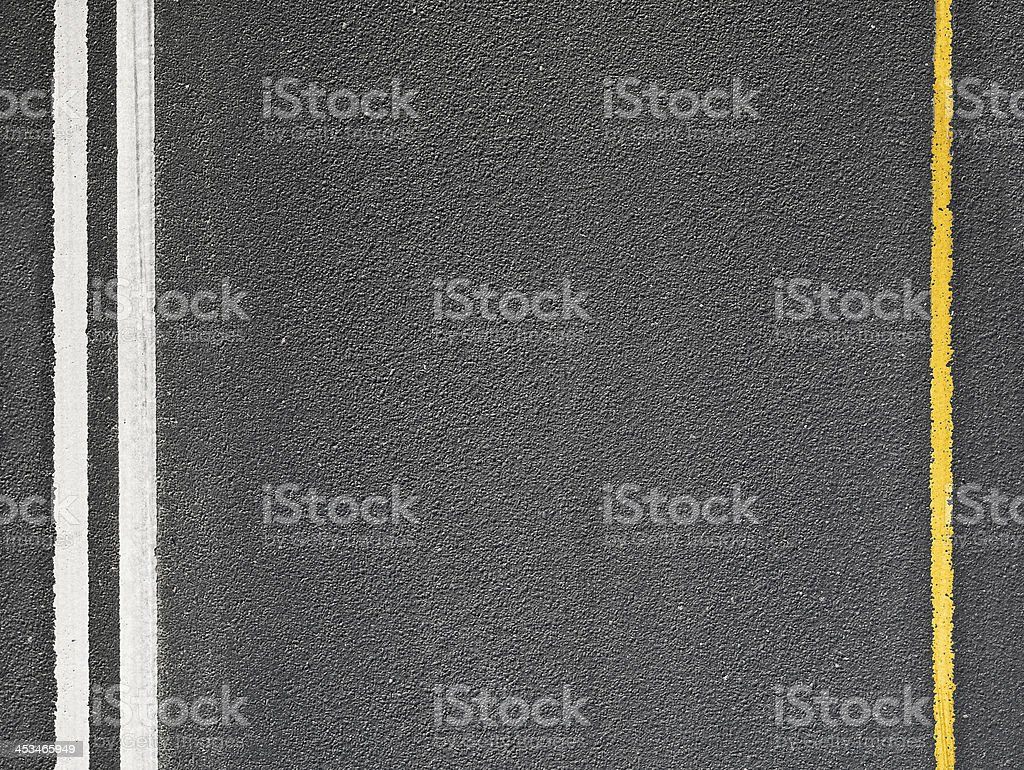 Asphalt road with marking lines. Close-up background texture stock photo