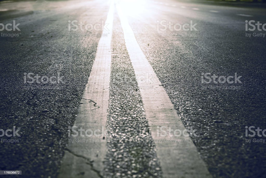 Asphalt road with two white lines stock photo