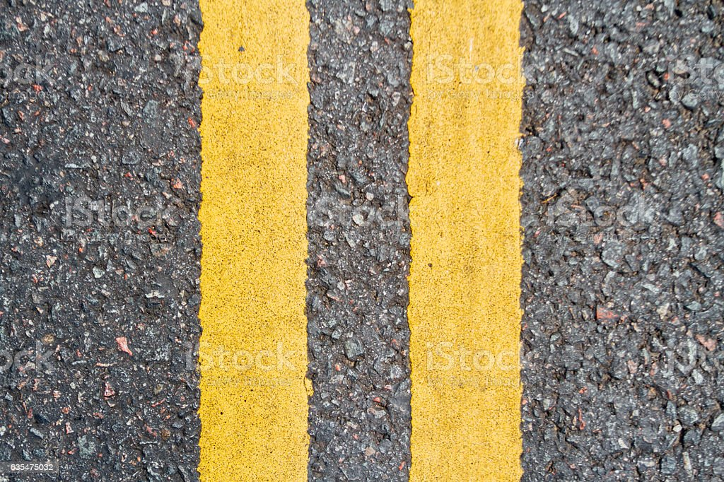 Asphalt road with two yellow lines seen from top stock photo