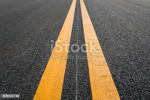 Asphalt road with yellow double line