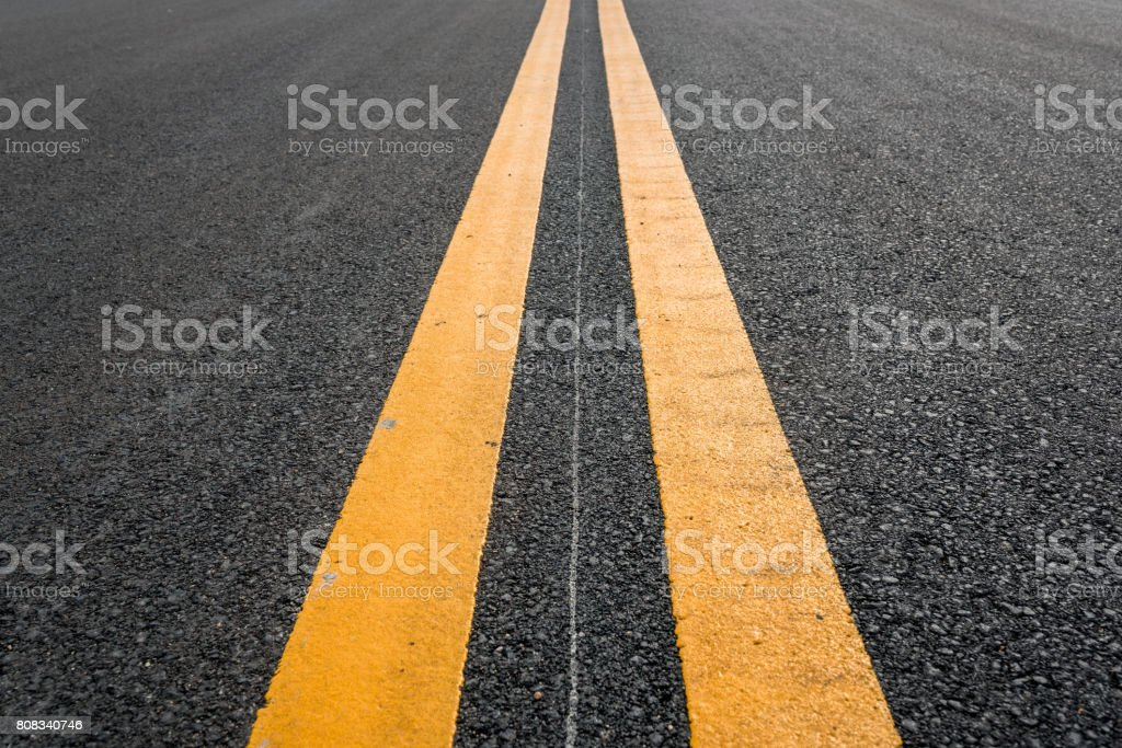 Asphalt road with yellow double line stock photo