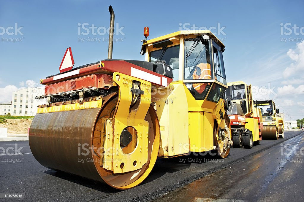 asphalt roller at work stock photo