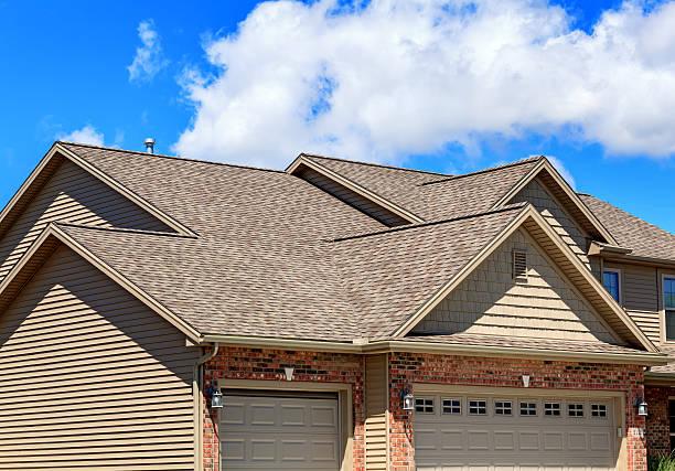 Asphalt roofing shingles on new home stock photo
