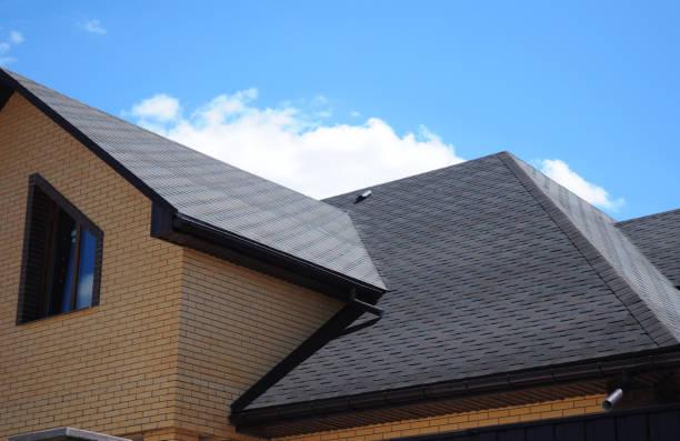 Asphalt shingles roofing construction, repair.  Problem Areas for House asphalt shingles Corner Roofing Construction Waterproofing. Rain gutter system. stock photo