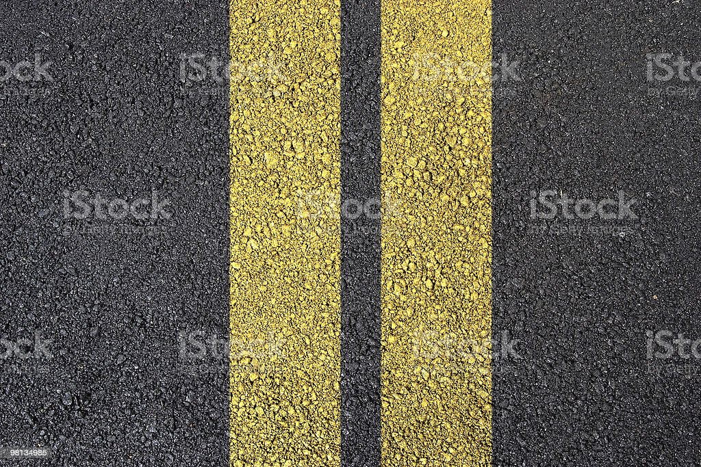 Asphalt surface with yellow line royalty-free stock photo