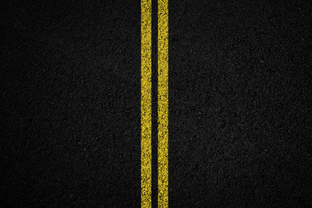 Asphalt texture background Double yellow line on black asphalt background middle of the road stock pictures, royalty-free photos & images