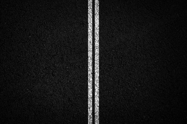Asphalt texture background Double white line on black asphalt background middle of the road stock pictures, royalty-free photos & images