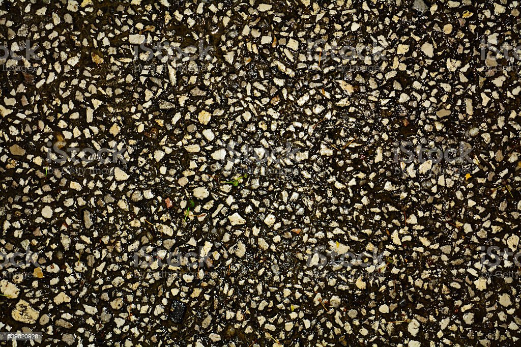 Asphalt texture with marbles stock photo