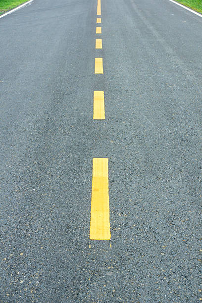asphalt texture with yellow dashed line. - dotted line stock photos and pictures