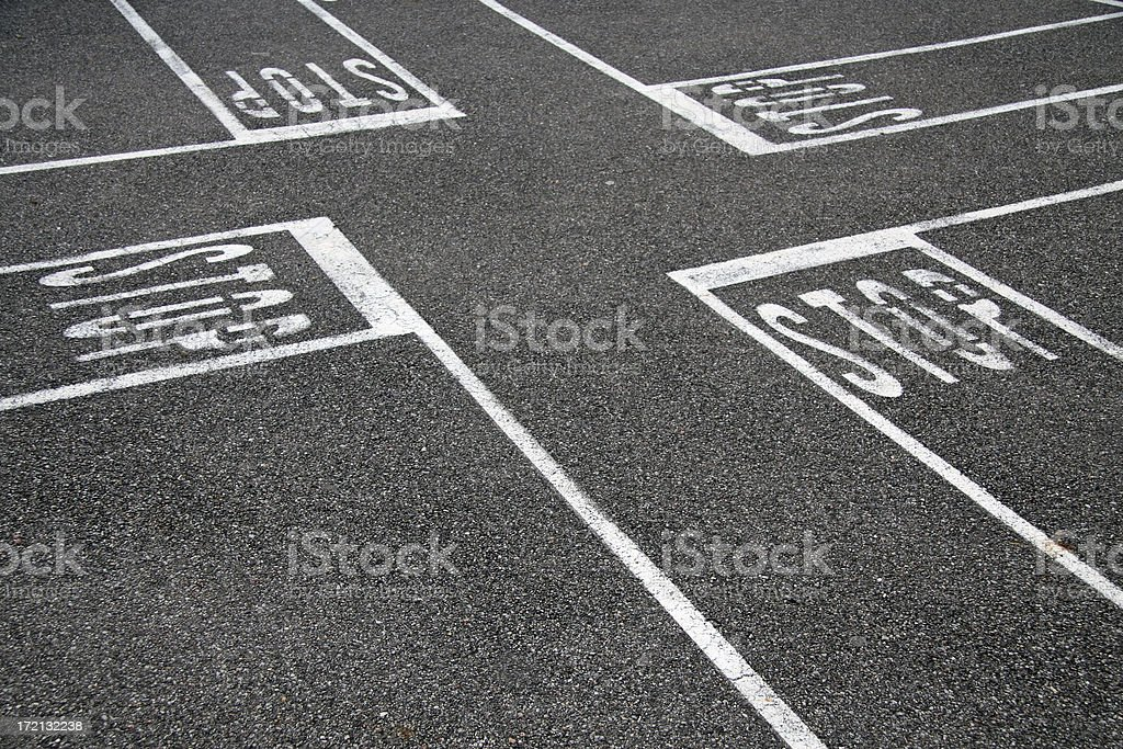 Asphalt with white lines marking an intersection