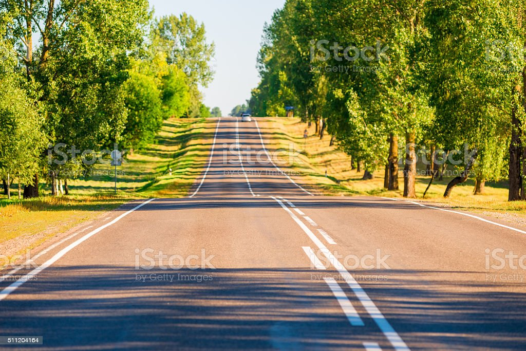 asphalted suburban road in a picturesque location stock photo