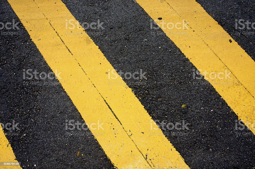 Asphaltic concrete road background and traffic sign stock photo