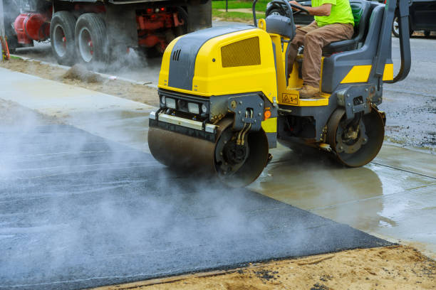 Asphalting construction works with commercial repair equipment road crews Asphalting construction works with commercial repair equipment road parking for the car with roller compactor machine compactor stock pictures, royalty-free photos & images