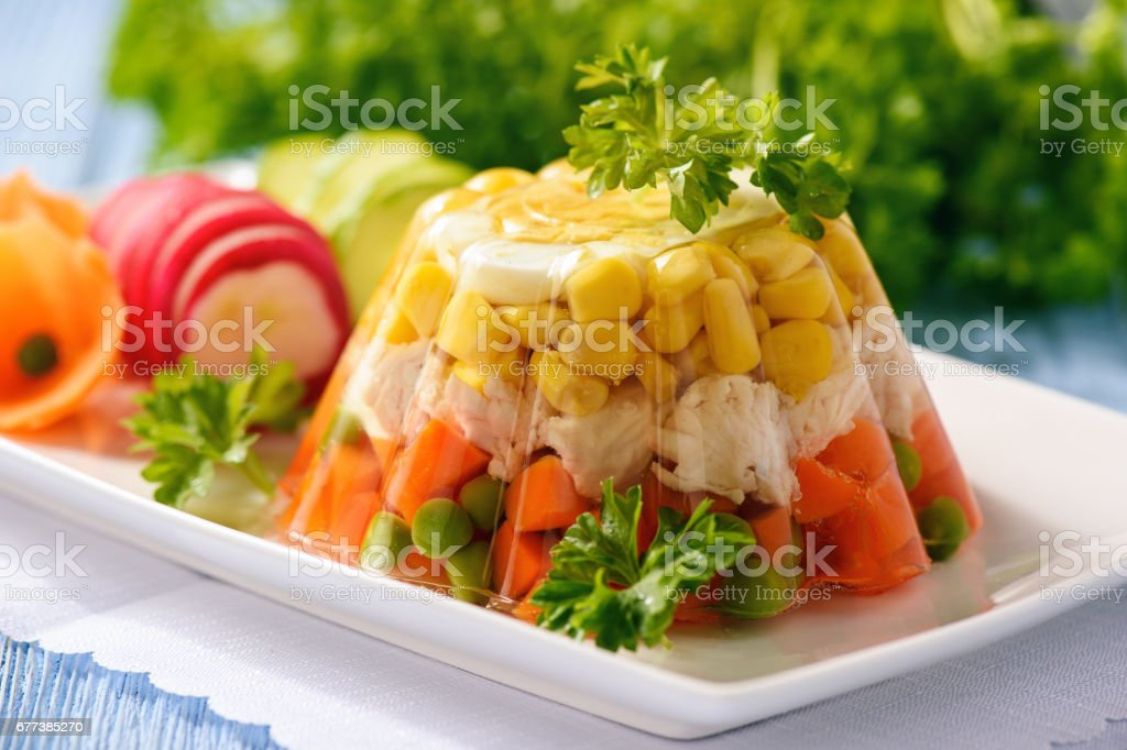 Aspic- jellied chicken with egg and vegetables. stock photo