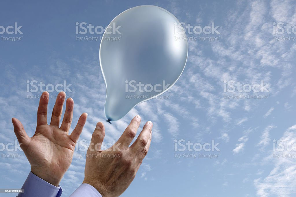 Aspirations concept with hands and balloon stock photo