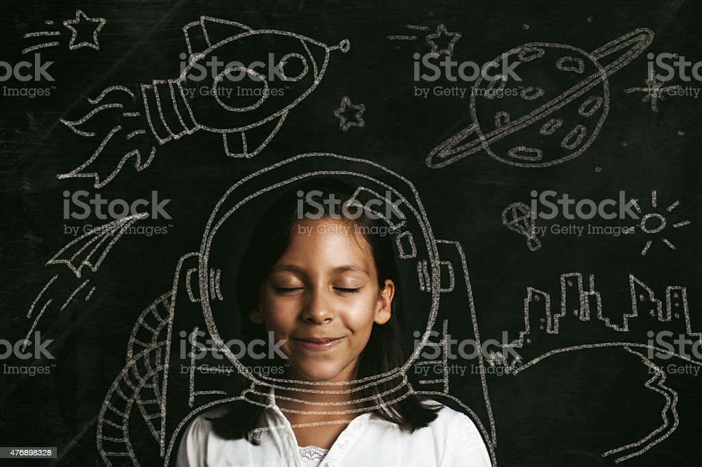 aspirations to be an astronaut Young girl dreaming of flying to space. Illustrative concept. 2015 Stock Photo