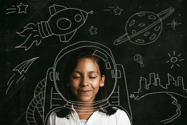 aspirations to be an astronaut Young girl dreaming of flying to space. Illustrative concept. dreamlike stock pictures, royalty-free photos & images