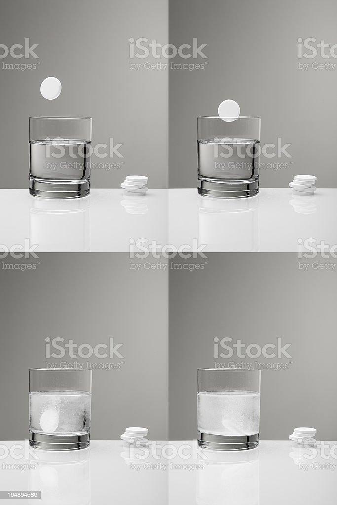 Aspirin paracetamol pill splashing into glass of water (sequence) royalty-free stock photo