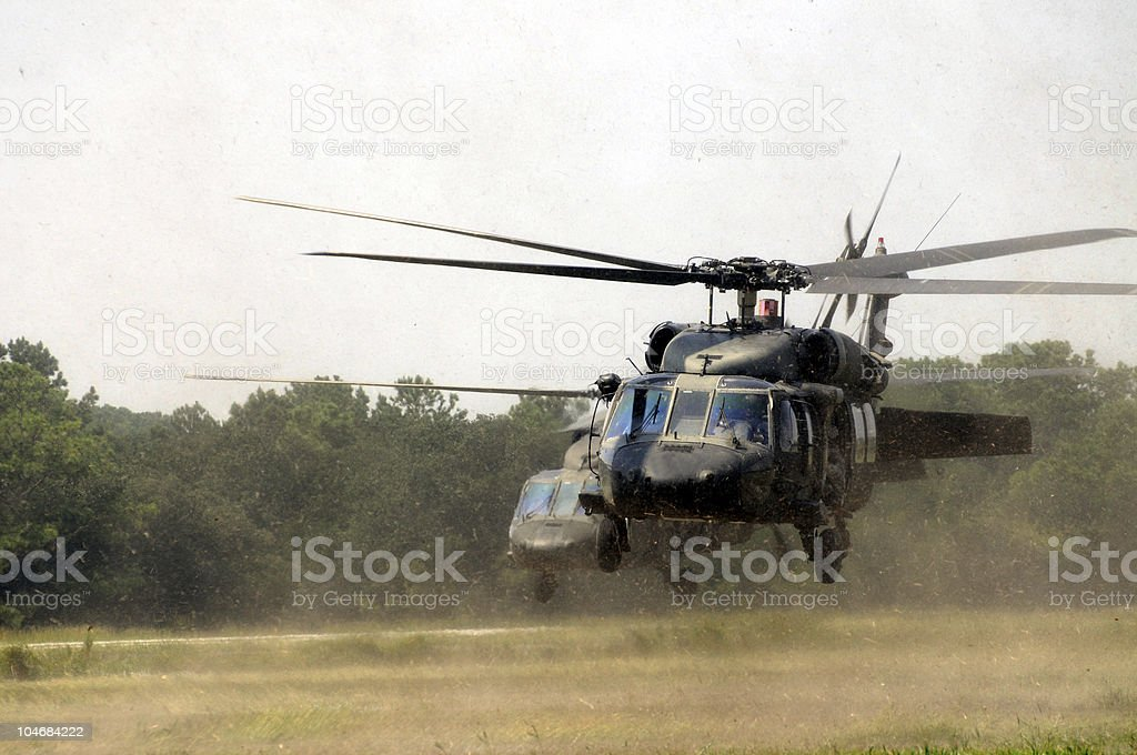 Assault helicopters taking off stock photo