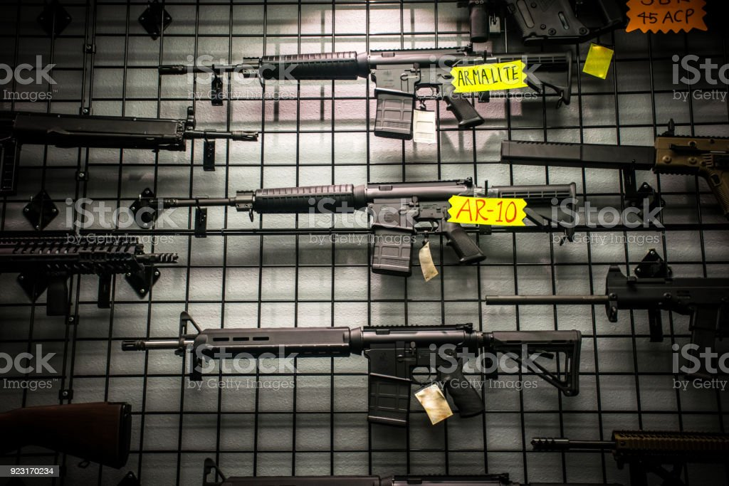 Assault Rifles for sale like the AR-15 and AR-10 hanging on the wall stock photo