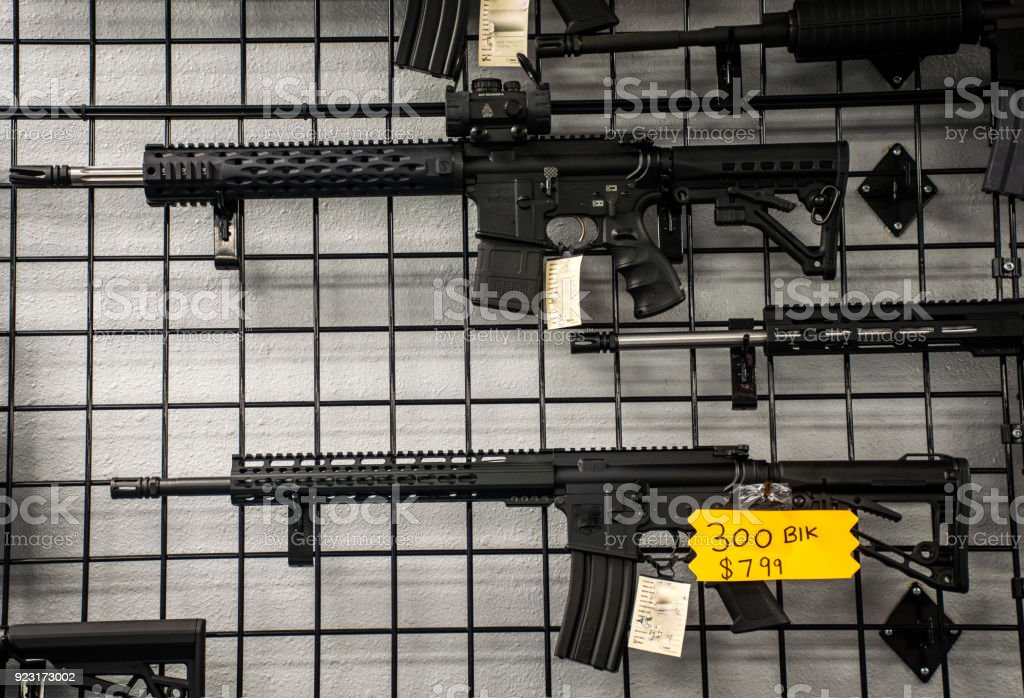 Assault Rifles on the wall for sale in America stock photo