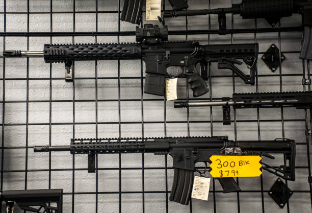 Assault Rifles on the wall for sale in America Assault Rifles on the wall for sale in America gun shop stock pictures, royalty-free photos & images