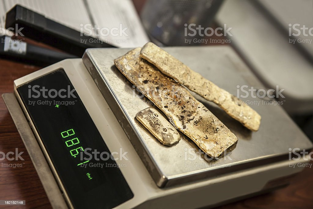 assayed gold bars on a penny weight scale stock photo