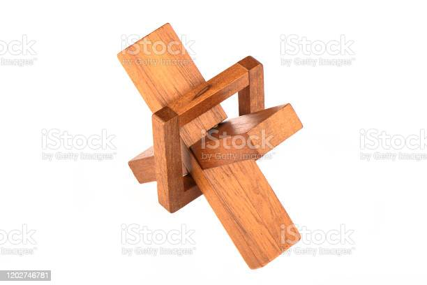 Assembled wooden cross puzzle isolated on a white background picture id1202746781?b=1&k=6&m=1202746781&s=612x612&h=2goygfscpf34l5wacaikby ehongntxuiak qr1tyze=