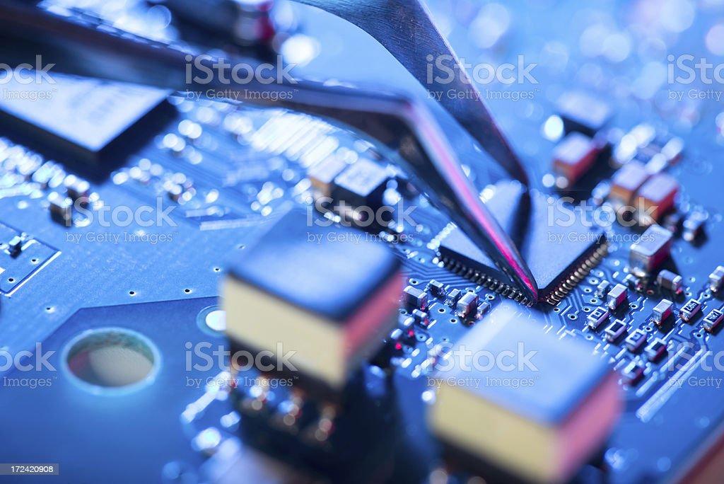 Assembling a circuit board. stock photo