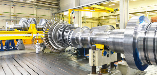 assembling and constructing gas turbines in a modern industrial factory assembling and constructing gas turbines in a modern industrial factory turbine stock pictures, royalty-free photos & images