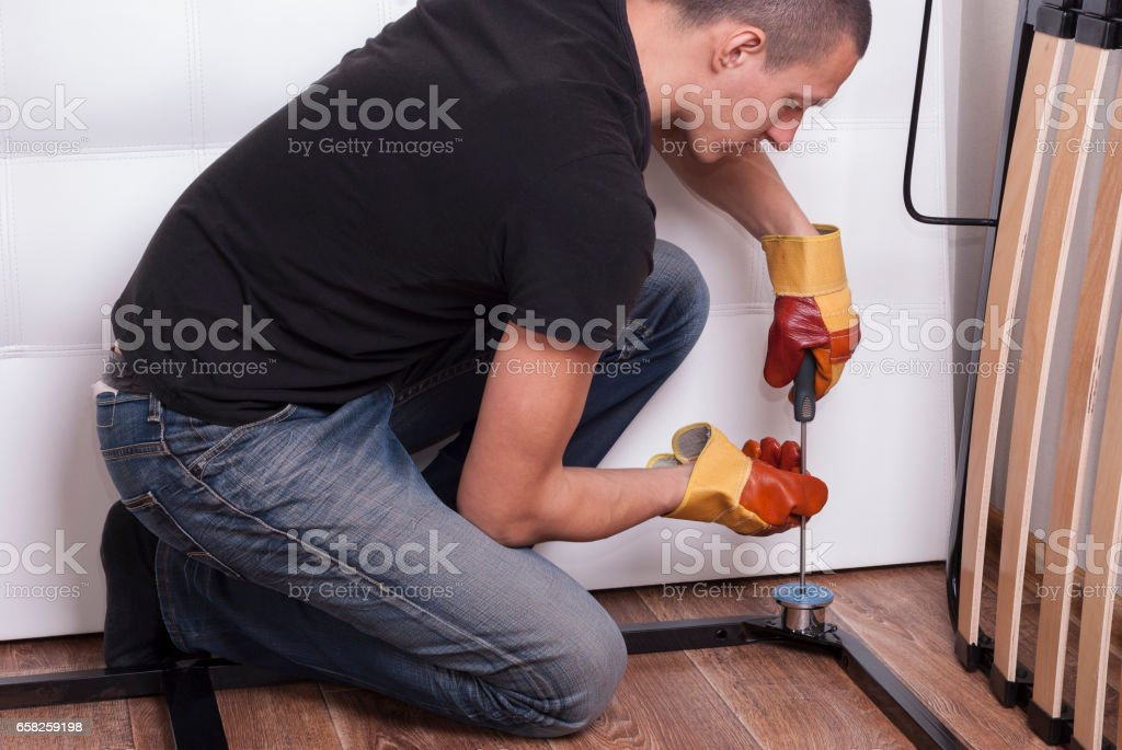 assembling bed furniture stock photo
