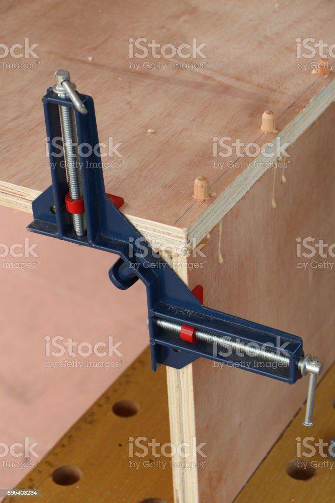 Assembling furniture, clamping stock photo