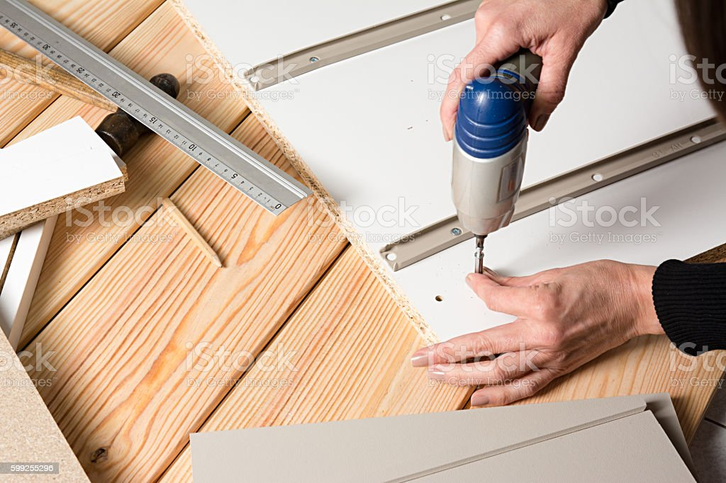 Good ... Assembling Furniture From Chipboard, Using A Cordless Screwdrive Stock  Photo ...
