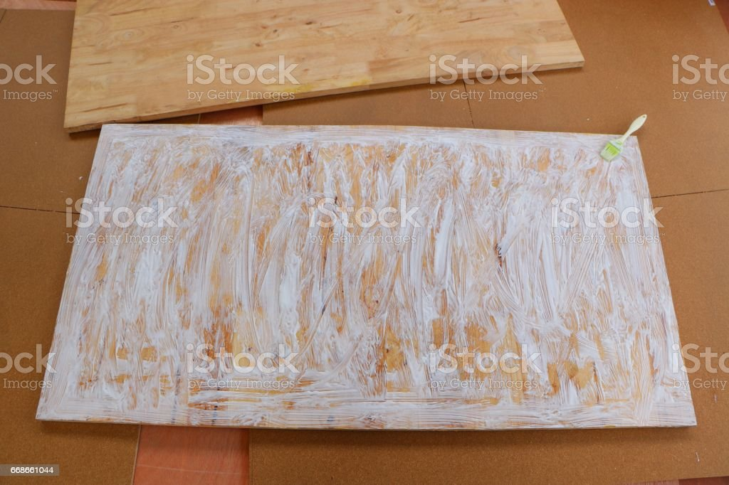 assembling furniture, glue on a plank stock photo