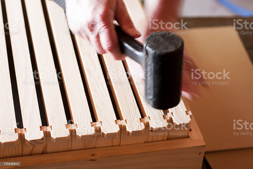 Assembling Hive Frames - Hammering the Top Bars royalty-free stock photo