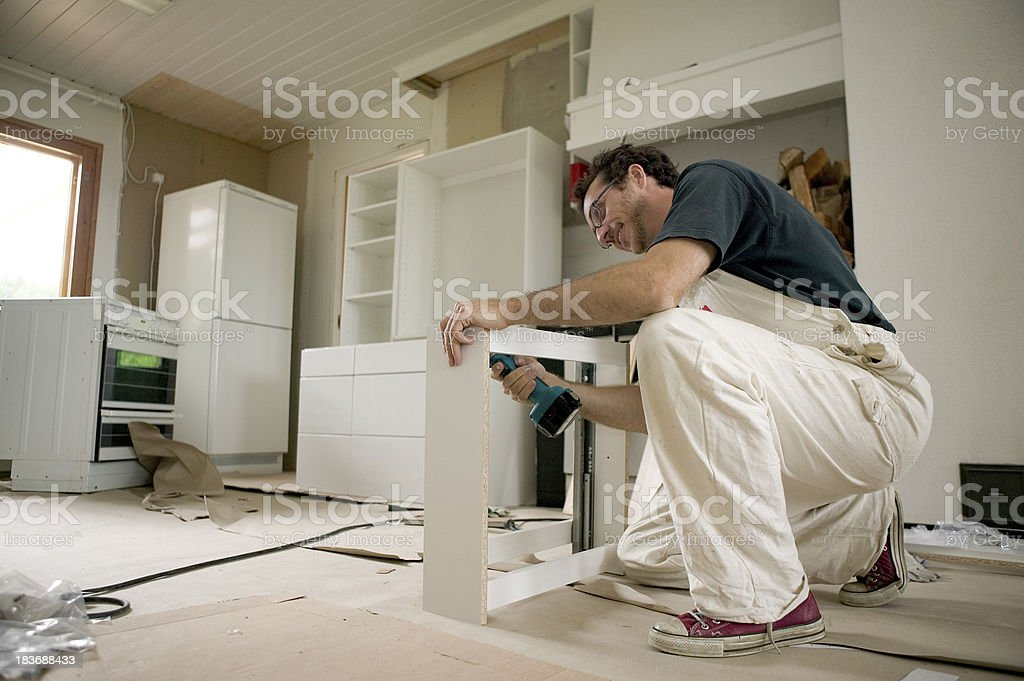 Assembling kitchen units. stock photo