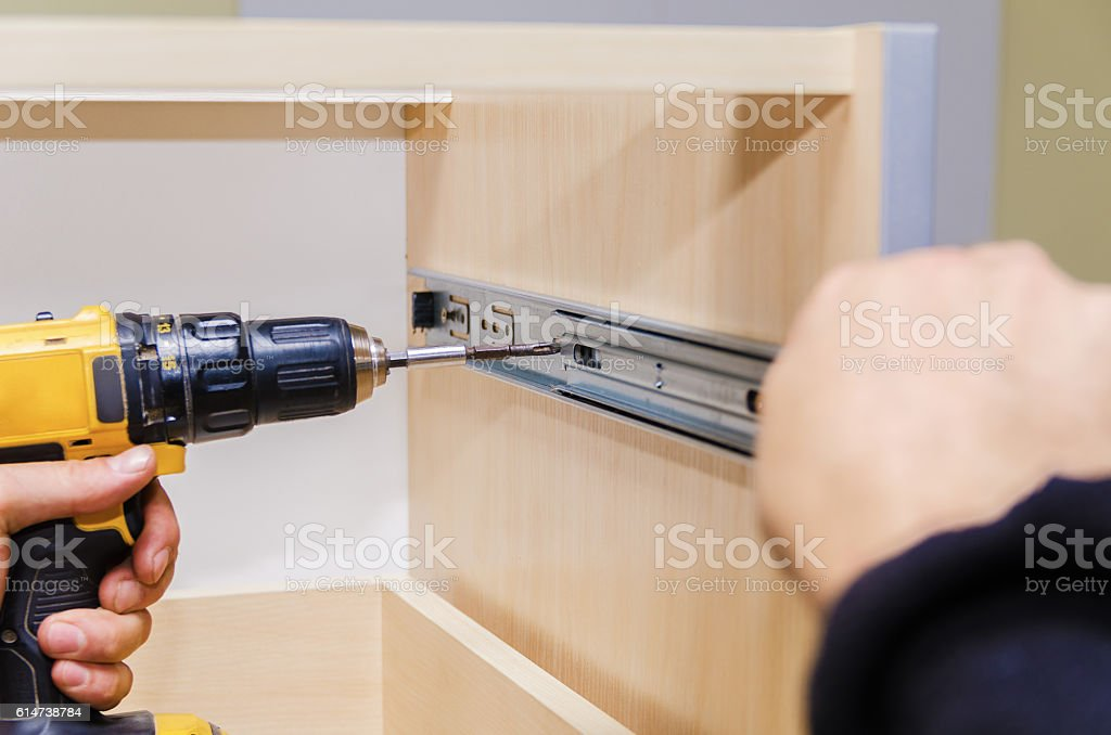 Assembling of furniture closeup stock photo