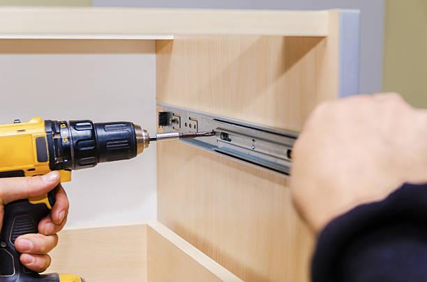 assembling of furniture closeup - telefonschrank stock-fotos und bilder
