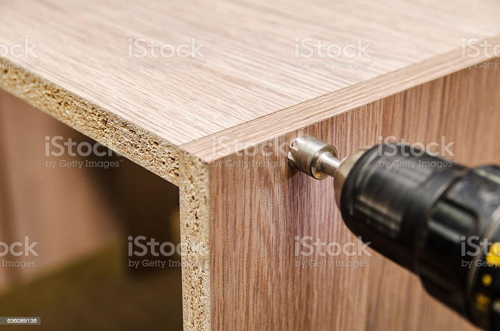 Assembling of furniture power tools stock photo
